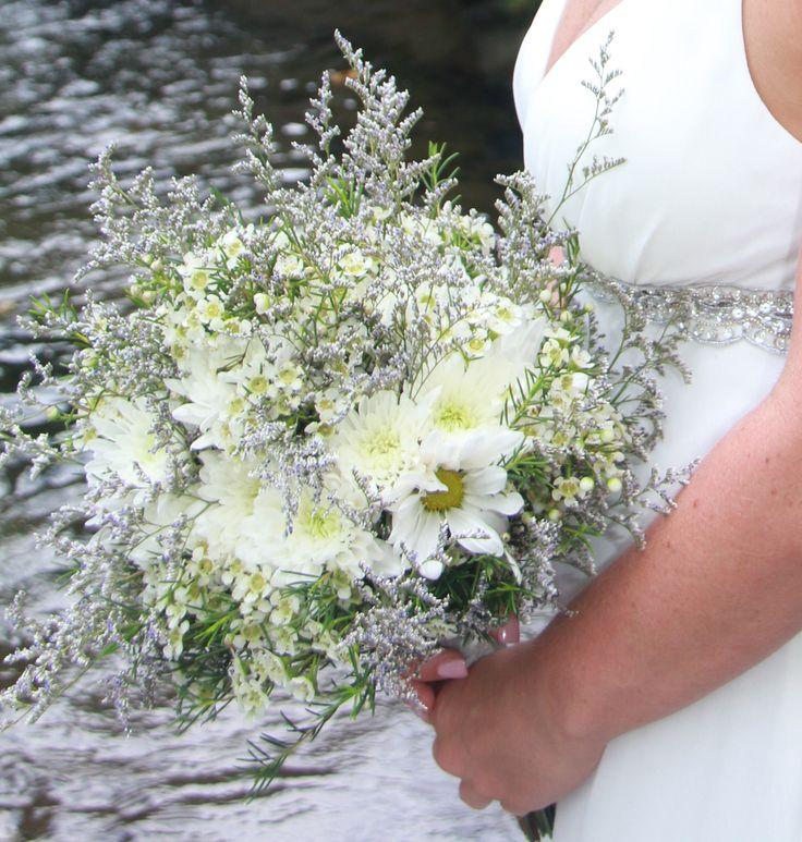 Rustic - white wax flower, white cushion poms, white daisies, dusty blue limonium (looks purple)