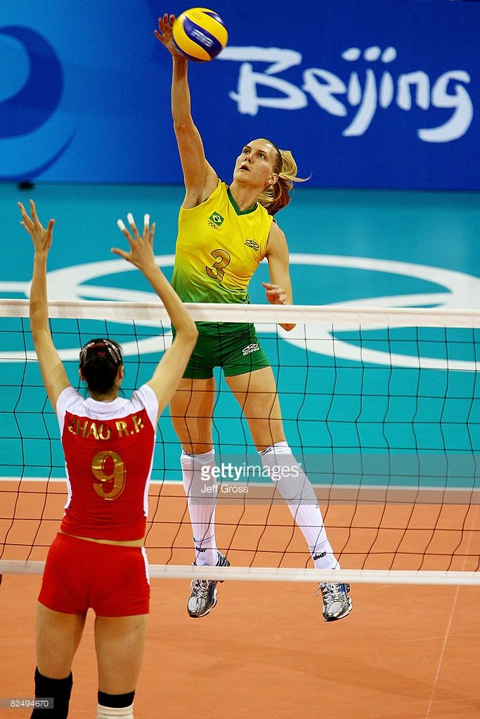 Marianne Steinbrecher of Brazil hits the ball over Zhao Ruirui of China in their Women's Semifinals volleyball game held at the Capital Indoor Stadium during Day 13 of the Beijing 2008 Olympic Games on August 21, 2008 in Beijing, China.