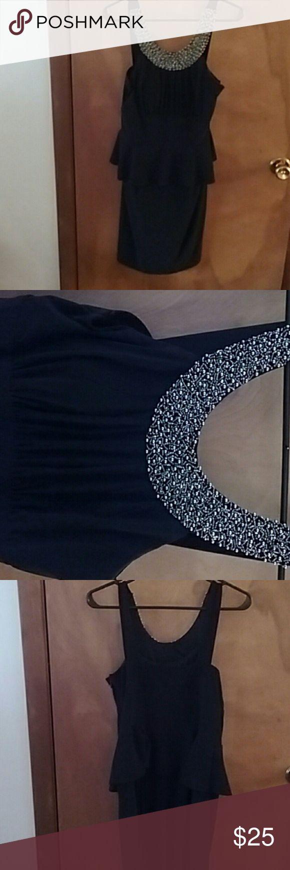 Black peplum dress Sleeveless black peplum dress with a beaded neckline, only worn once! Jackie Jon Dresses Midi