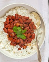 Basic red beans and rice recipes are ubiquitous in many cuisines for a reason: kidney beans soak up a ton of flavor and, when served over rice, will keep you full for hours. While some cooks use ham or sausage, this Puerto Rican-inspired meal uses bacon lardons.   Slideshow: More Canned Bean Recipes
