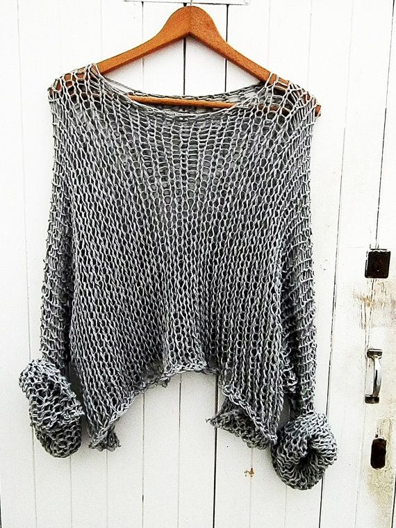 Beautiful loose knitted gray sweater.  The perfect for summer, when all you need is a lightweight sweater to drape . Created from a soft cotton yarn and loose knitted. Lovely with a dress or jeans and a t-shirt.  Available in other lovely colors. 100% COTTON
