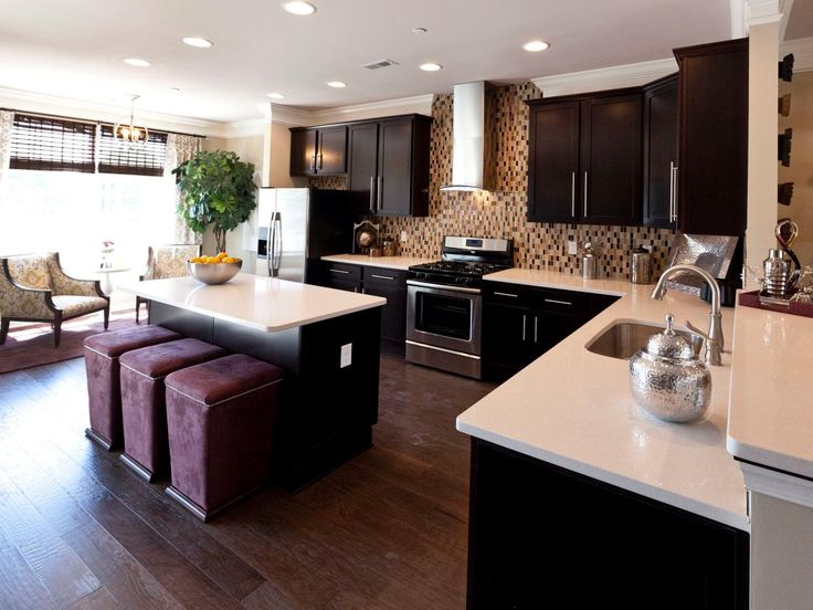 Mosaic tile along one wall of this open-concept kitchen ...