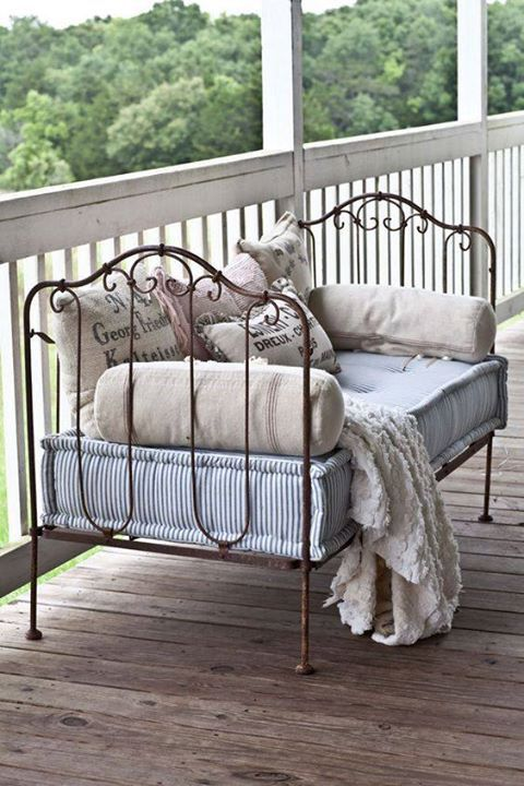Love this idea, recycled vintage day-bed into a charming bench.