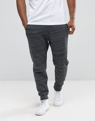 Hollister - Pantalon de survêtement resserré aux chevilles avec effet chiné multicolore et texturé - Noir