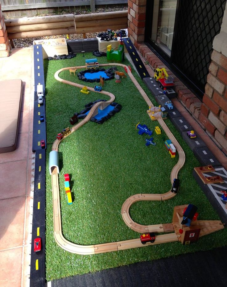 Transforming a small outdoor space on the patio into a car/train track for play.