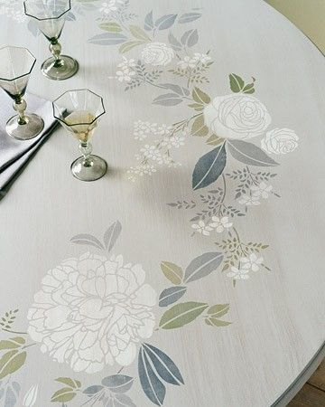 Nearly as simple as a paint-by-numbers project, this stylistically stenciled tabletop design requires only a steady hand, a floral stencil kit, sponges, drafting tape, and acrylic paint to create the illusion of a beautifully blossoming interior. Begin with a latex-painted table, and select a paint palette that complements the surface's hue.