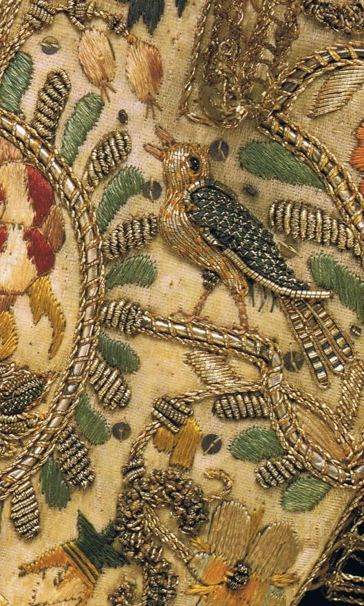 Satin Gauntlet embroidered with silk and metallic thread, purl   and spangles, trimmed with silk ribbon and silver-gilt bobbin lace…  English c. 1600-1625.