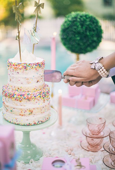 Naked Wedding Cake with Confetti Sprinkles. An already whimsical naked cake from Paper Cake Events gets brightened up with a generous helping of confetti-shaped sprinkles.
