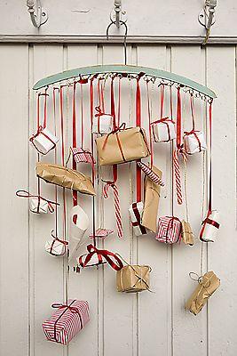 Sweet Paul's advent calendar on a vintage hanger... such pretty colors