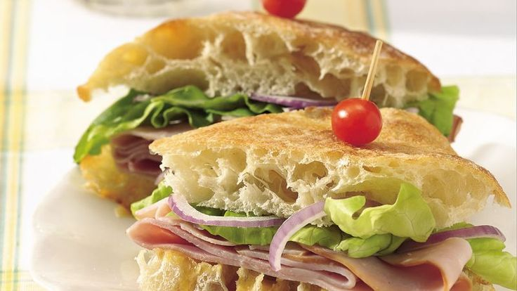 Honey-raspberry Dijon mustard upgrades Virginia ham on specialty bread in these savory sandwiches.