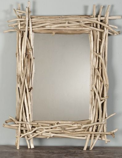 Would like to try a star for Christmas... How to make a cool twig mirror from iVillage @totgreencrafts #DIY #Upcycle