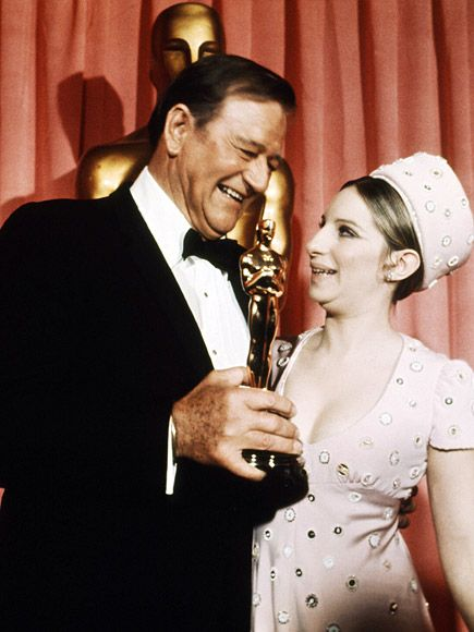 20 Incredibly Classy Vintage Pics of Academy Awards Winners Past | JOHN WAYNE & BARBRA STREISAND | The Duke and Babs celebrate Wayne's 1970 Best Actor win for 1969's True Grit.