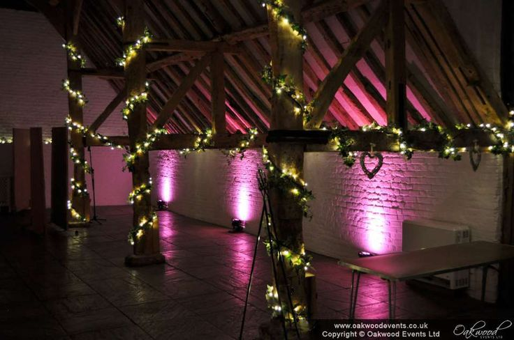 Pink uplighting in the Ufton Court barn