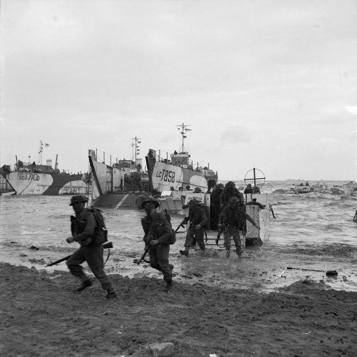 Commandos of 47 (RM) Commando coming ashore from LCAs on Jig Green Beach, Gold Beach area, June 6, 1944. 231st Brigade, 50th Division unloading in background.
