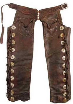 "These seamless leather pants have a shape that reminded one of a double-barreled shotgun, hence the name ""Shotgun Chaps. Typically they were held together by a belt that fit straight across the waist and often were decorated along the outside seam with long fringe. The chaps that didn't have a fringe were called ""closed-leg"" chaps."