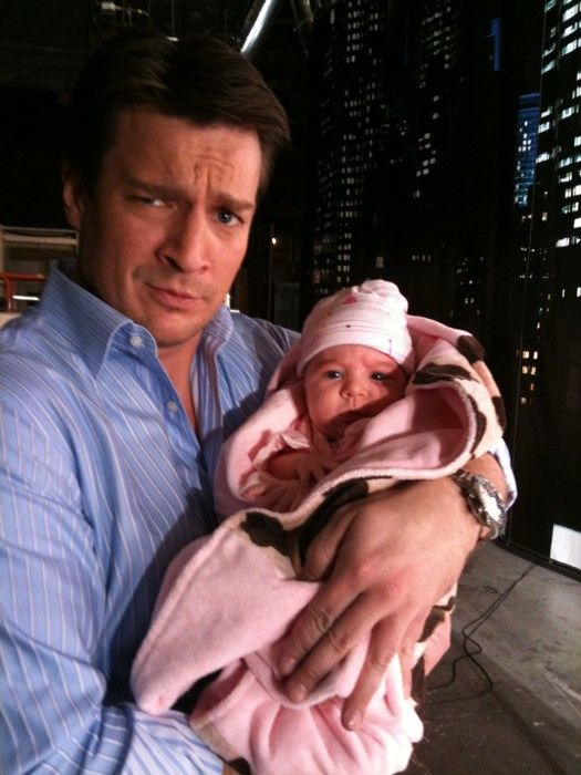 Nathan Fillion Holding A Baby Your Argument Is Invalid Silliness Pinterest Nathan Fillion Geek Stuff And Baby