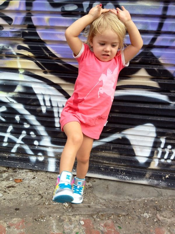 Super cute Mila rocking her cool kicks and our Pegasus Training dress with a classic Melbourne street art backdrop.