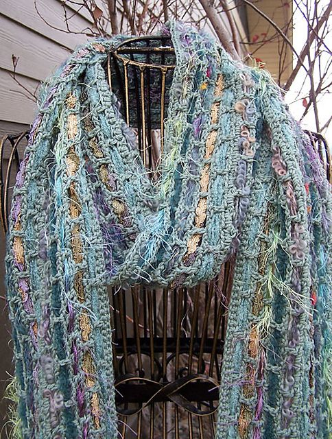 Woven Ribbon Scarf, by Cathy Pipinich.  **Pattern not free.  Scarf is a woven mesh ground with ribbons &/or boutique yarns woven through -- a great way to use those beautiful but tear-your-hair-out fancy yarns  :-)  #crochet