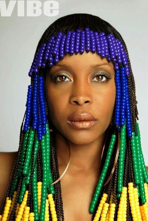 Erykah Badu Decked Out In Blue Green And Yellow Beads