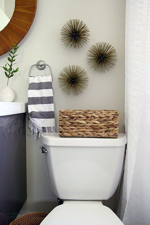 These fun sea urchins ($20) add a textural element to the bathroom and are a smart, easy way to fill the awkward space above the toilet.