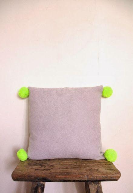 neon yellow pom pom cushion with grey warwick by