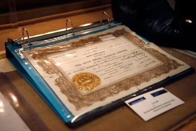 Birth Certificate protected in a notebook - Andy Kropa / Getty Images