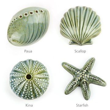 Sea Shore Ceramics by Bob SteinerHang them on your wall or display them on a table.The glaze is a wonderful blend of blue and green that works well with either colour palette.Kina - or the common sea urchin, is considered a delicacy by Maori. Resembling a curled-up green hedgehog, kina has a nearly spherical shell protecting its internal organs. This is what is represented here and can often be found on beaches to be collected by New Zealand children of all generations. 12cm dia x 7cm