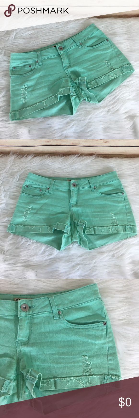 """✨ Mudd mint green Jean shorts ✨Newly listed items are priced to move.. please help me clear out my actual closet 😉 Brand: Mudd Size: 11 Color: mint green Details: four functioning pockets, manufacturer rips on front, cuffs are sewn  Measurements: waist- 15.5"""", inseam- 2.5"""", outseam- 10"""" Condition: preloved: good *slight discoloration/marks in a few areas but hard to see  ✨Build a bundle with all your likes and use the automatic bundle discount -or- make me a bundle offer✨ Mudd Shorts Jean…"""