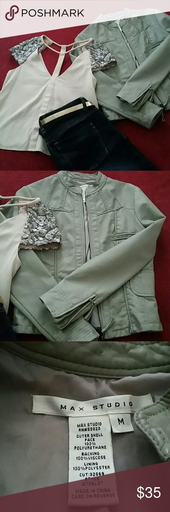 Soft supple faux leather Max Studio moto jacket Shed a tear for me,snif snif. NWOT absaloutly gorgeous taupe gray, details to the max. Zipper closure, zippered sleeves. Waist narrowing details. Love love love. Just a tad to small for me :( Size med Max Studio Jackets & Coats