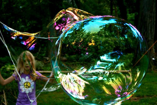 This has a DIY in the comments section on how to make the bubble solution and the wands to create these giant bubbles.  Thinking with taking photographs of my kids this Summer how cool would this be!  Or for family photo shoots at a park or the beach, have them working to create these beautiful large bubbles, might create some interesting photos perhaps?
