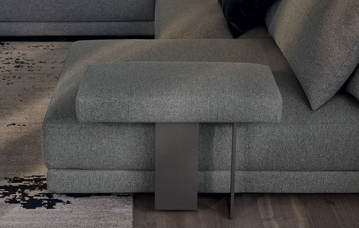Poliform_Bristol sofa covered in removable fabric with horizontal arm with structure in piombo painted metal.