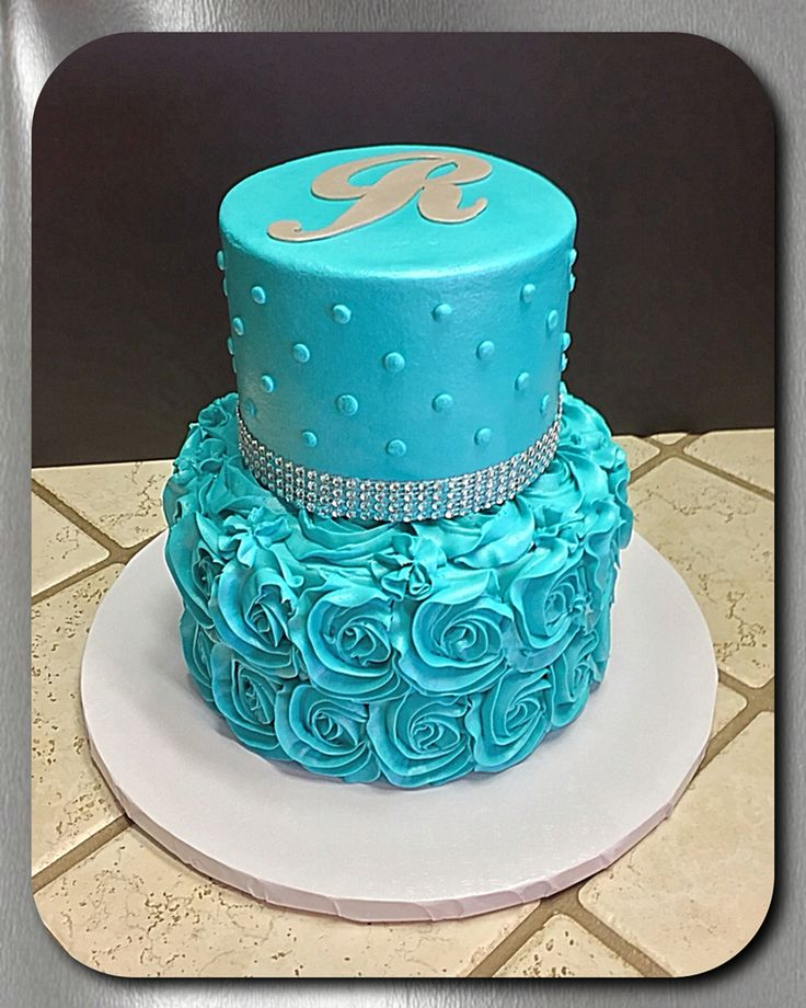 Turquoise rosette and rhinestone border tiered cake :)