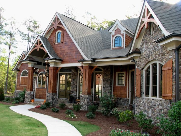 Love the STONE on the exterior.....and I love the windows and the beautiful wooden pillars!!!  <3