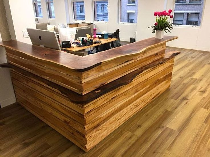 Custom reception desk in natural wood with live edge finish for home office
