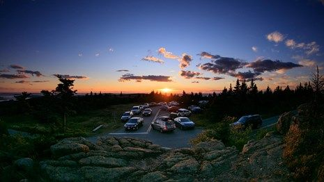 Traffic jam at Blue Hill Overlook with the sunset in the background.