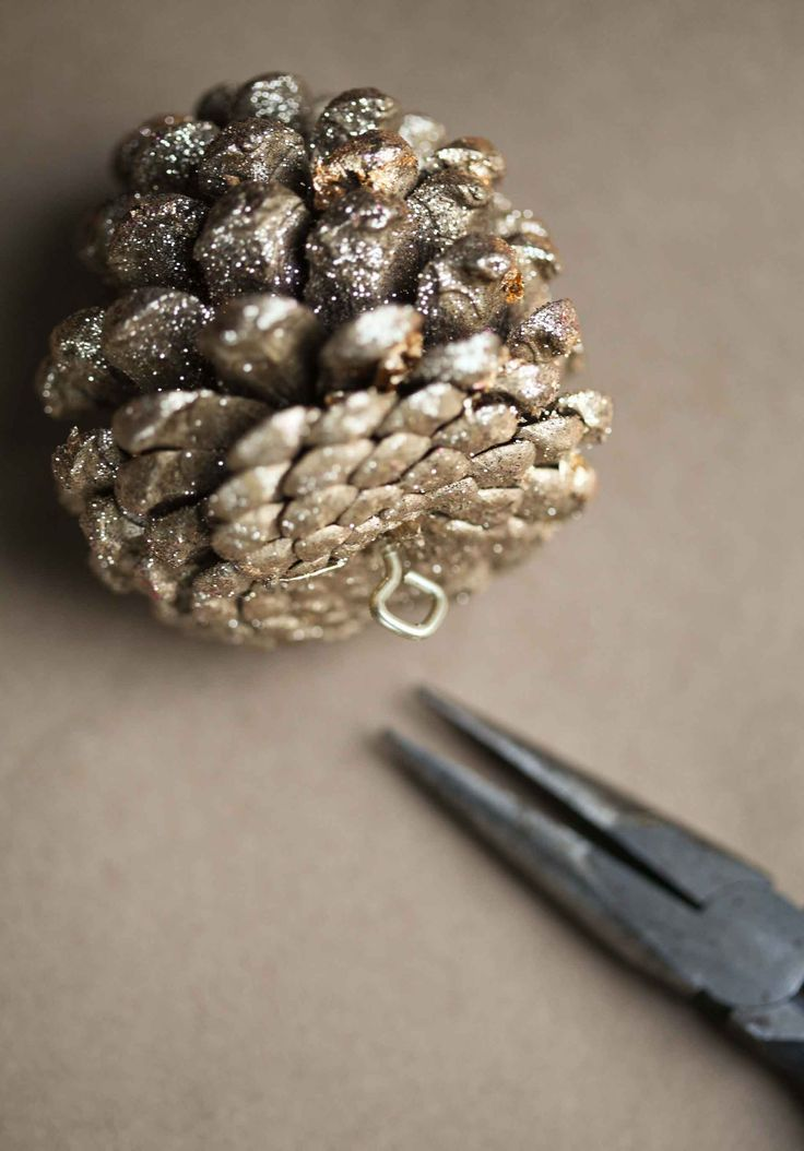 Golden pine cones prepared as Christmas ornaments  | #Christmas #Crafts #Family #Fun  Sherman Financial Group