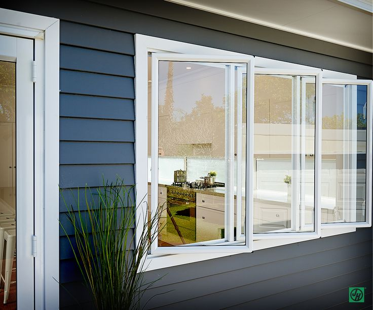 Bi-fold windows in white to off set the linea weatherboards James Hardie