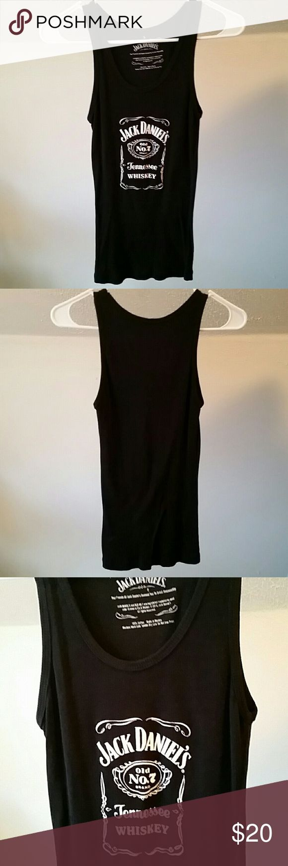 Excellent condition! Jack Daniels tank top. Bought in Lynchburg, Tennessee... home of Jack Daniels whiskey! This cute tank top was worn one time. There are no stains, holes, tears, or fading. Comes from a smoke-free home. Jack Daniels Tops Tank Tops