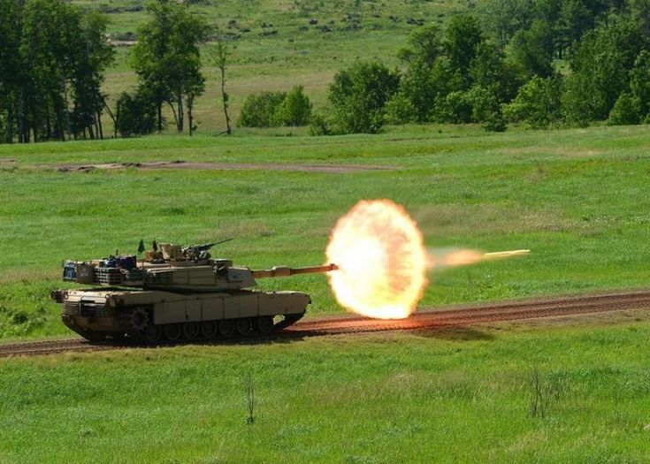 M1 Abrams tank firing a sabot round.36 Perfectly Timed Military Photos | PressRoomVIP - Part 11