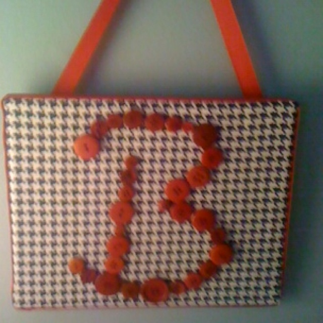 DIY monogramed canvas. Cover a 8x10 canvas with about 1/8 a yard of fabric. Hot-glue buttons on top and finish with a ribboned border around the edges, also making your own hangar. Cute, personal gift for about $10!