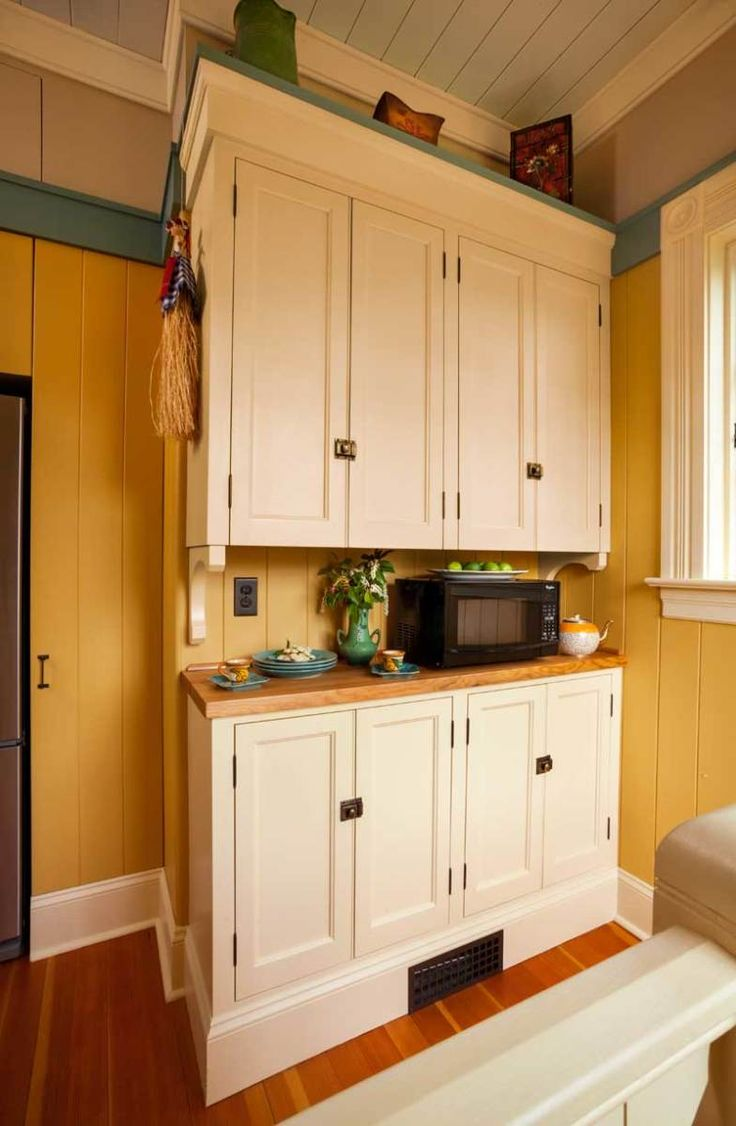 Key elements in this kitchen come from the Swedish Arts & Crafts aesthetic popularized by Carl Larsson.