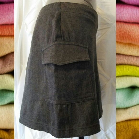 Gray Express skirt w/pockets EXPRESS SKIRT GRAY  HAS ZIPPER IN BACK AND 2 FUNCTIONAL SIDE POCKETS.  GREAT CONDITION NO FLAWS  DRY CLEAN ONLY  MEASUREMENTS  WAIST 33IN. LENGTH 15.5 IN.  Material content  63% POLYESTER 21% RAYON 13% COTTON 3% LYCRA SPANDEX Express Skirts