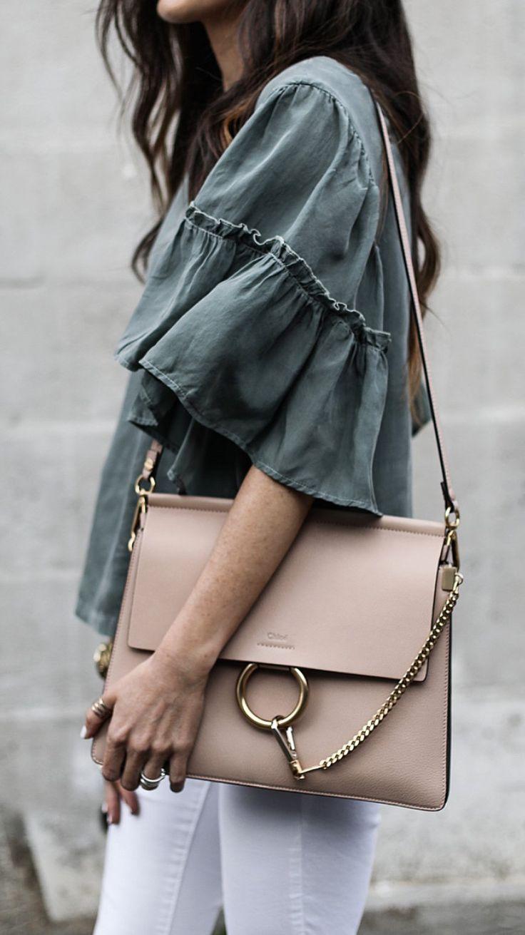 Dark Blouse & Beige Leather Shoulder Bag & White Skinny Jeans