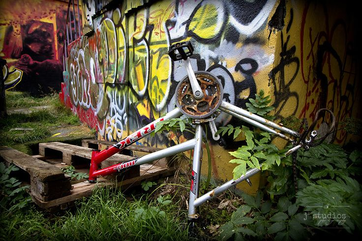 Bike Art is an art print of a mountain bike frame in front of graffiti.