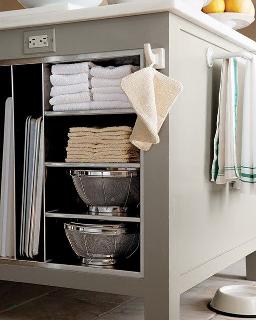 "Decide what you want to keep in the islands, and plan the space accordingly. ""Upright steel slats provide perfect spots for heavy baking sheets,"" Martha says. She also has drawers for aprons and utensils; deep shelves for platters, books, and pet supplies; and small cubbies for towels and other items."