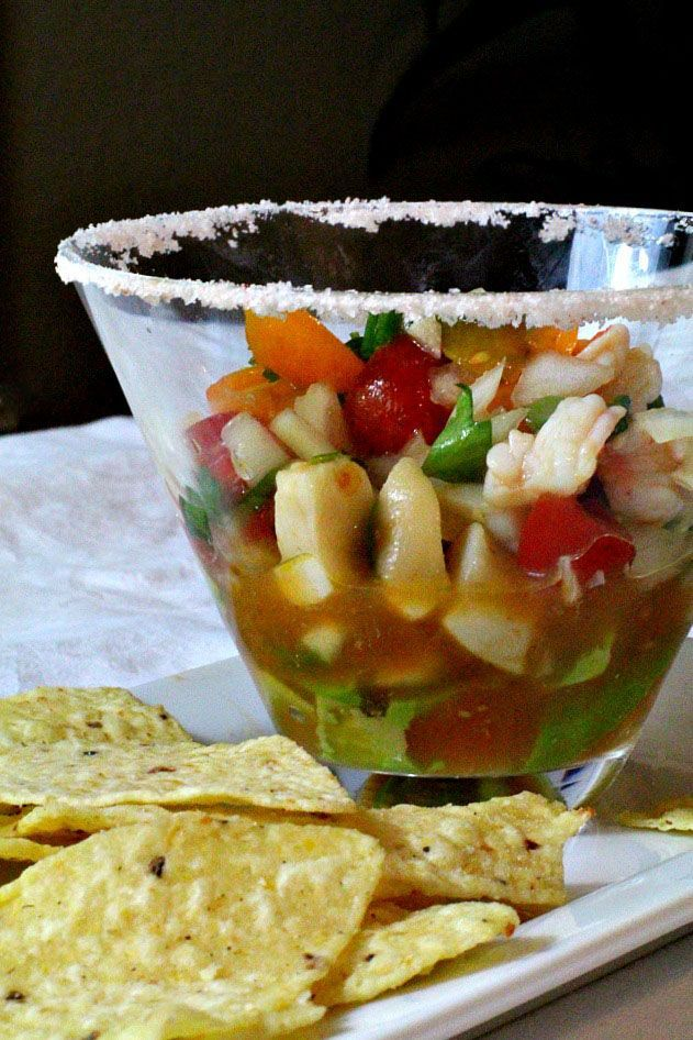 Shrimp and scallops are gently poached and soaked in a lemon, lime, orange juice bath. The citrus flavors are outstanding in this healthy ceviche appetizer recipe.