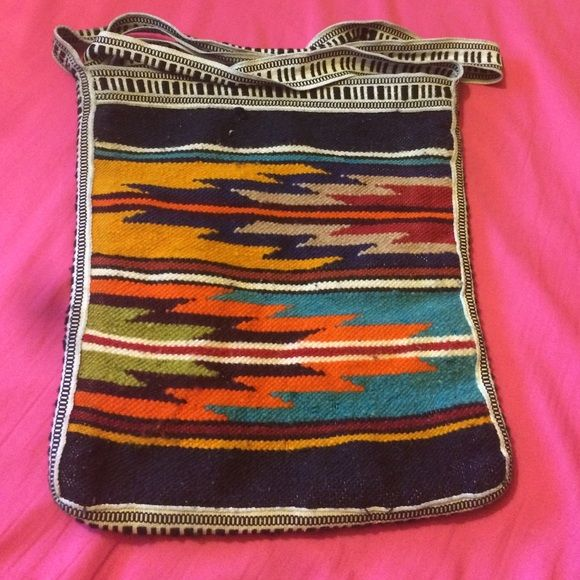 Mexican satchel Well it's hand made, it has two different design. The front has a pattern the back has a house, birds, plant plots and a fence. It does have some wear on it. Bags Satchels