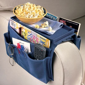 Our Sofa Over Arm Caddy allows you to organize your magazines remote controls eye glasses your cell phone TV Guide or anything you need near you while you are sitting on the sofa or in your recliner. This family room organizer stores all the stuff that gets lost or slides under the cushion. The chair arm caddy features