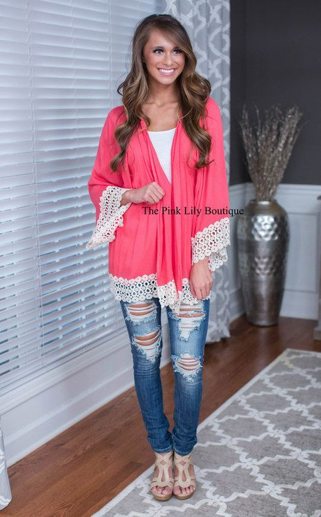 Light up anywhere you go in this vibrant cardigan! We are loving the ivory lace detail along the edges and the lightweight feel! Layer it over a cami with shorts or jeggings for your favorite look!