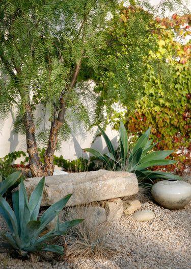 stone slab bench - small boulders - gravel - agaves - pepper tree - grasses